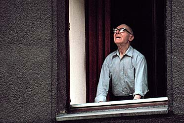 About God and the world - old man looking out of the window