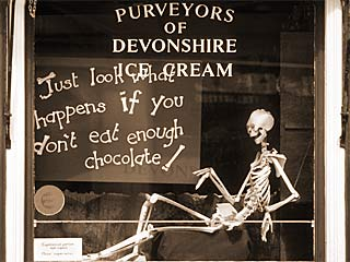 """Just look what happens if you don't eat enough chocolate!"" - window of a chocolate shop in England"